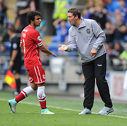 Cardiff City Caretaker Manger Scott Young celebrates Cardiff's  goal with Cardiff City's Fabio Da Silva - Photo mandatory by-line: Alex James/JMP - Mobile: 07966 386802 - 27/09/2014 - SPORT - Football - Cardiff - Cardiff City Stadium - Cardiff City v Sheffield Wednesday - Sky Bet Championship