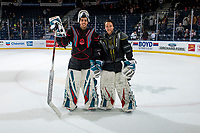 KELOWNA, CANADA - MARCH 16: Roman Basran #30 and James Porter #1 of the Kelowna Rockets pose on the ice after the jersey off your back presentation on March 16, 2019 at Prospera Place in Kelowna, British Columbia, Canada.  (Photo by Marissa Baecker/Shoot the Breeze)