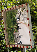 A mirror and tunnel lead to the Devil's Bridge, in the Tolmin gorges/Tolminska korita, Triglav National Park, Zatolmin, Slovenia, Europe. Walk a trail along Tolminka river gorge, starting at the parking lot at the Triglavski narodni park (TNP) sign, near Zatolmin in the Julian Alps. Loop upwards to the scenic Devil's Bridge (Hudicev most, built 1907), which carries Tolmin-Cadrg road sixty meters above Tolminka River. Tolmin gorges (Tolminska korita) are among the longest and deepest gorges in Slovenia and are the lowest point (180 meters elevation) in Triglav National Park (TNP).