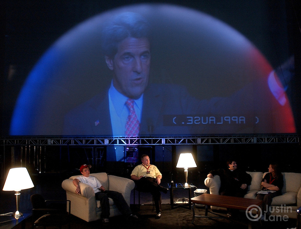 Workers at the Sands Expo Center watch United States Senator and Democratic Candidate for President John Kerry addresses the National Conference of the American Association of Retired People in Las Nevada, NV Thursday 14 October 2004...EPA/JUSTIN LANE