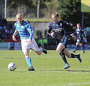 Dundee's David Clarkson runs at St Johnstone's Steven Anderson - St Johnstone v Dundee, SPFL Premiership at McDiarmid Park<br /> <br />  - &copy; David Young - www.davidyoungphoto.co.uk - email: davidyoungphoto@gmail.com