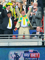 Norwich Director and Actor Stephen Fry jumps from his seat with excitement in the Directors Box, at Wembley as Norwich score their second Goal, Middlesbrough v Norwich, Sky Bet Championship, Play Off Final, Wembley Stadium, Monday  25th May 2015