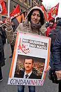 "Rome, Italy. 16th January 2016<br /> Protester holding a sign with a picture of Syrian President Bashar al-Assad with the words: ""Sentenced"",  during Anti-war demonstration on the 25th anniversary of the bombings in Iraq and against military spending, organized by the union USB, and the social platform Eurostop."