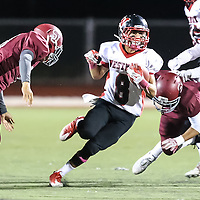 (Photograph by Bill Gerth for SVCN) Westmont  #8 Elijah Trevino looks for yardage vs San Jose in a BVAL Football Game at San Jose High School, San Jose CA on 10/7/16.  (Westmont 28 San Jose 20)