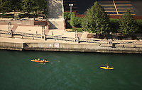 Kayakers float down the river in downtown Chicago, Illinois.