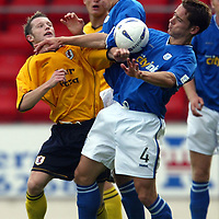 St Johnstone v Raith Rovers....20.09.03<br />Steven Robb battles with Paul Bernard and John Robertson<br /><br />Picture by Graeme Hart<br />Perthshire Picture Agency<br />Tel: 01738 623350 / 07990 594431