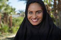 Portrait of muslim woman in black headscarf