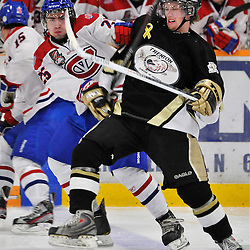 COBOURG, ON - Oct 19: Ontario Junior Hockey League game between Kingston Voyageurs and Trenton Golden Hawks. Ryan Johnson #91 of the Trenton Golden Hawks battles for position with Jarret Kup #25 of the Kingston Voyageurs during second period game action..(Photo by Shawn Muir / OJHL Images)