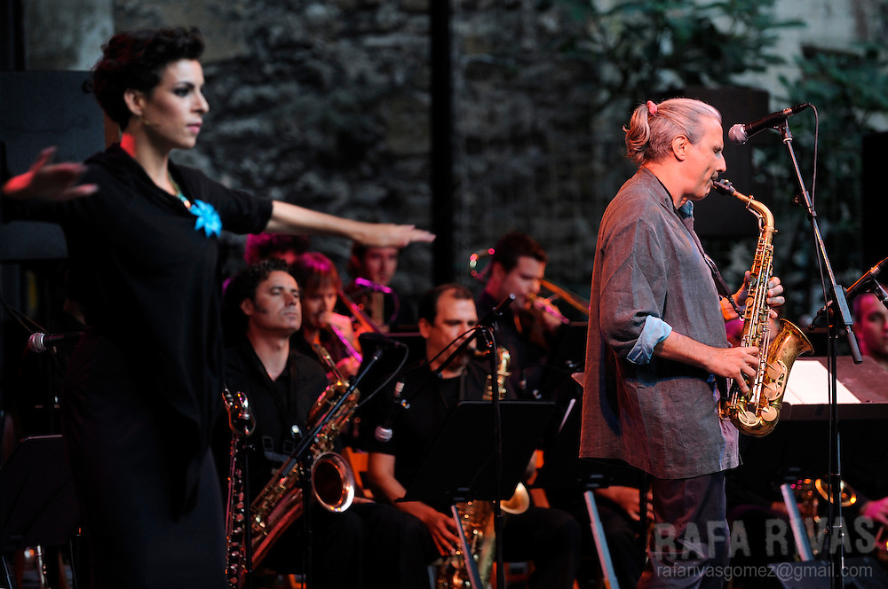 Spanish saxophonist Perico Sambeat (R) and flamenco dancer Ana salazar (L) perform with the Flamenco Big Band, during the 44th Jazzaldia Festival, on July 24, 2009, in the northern Spanish Basque city of San Sebastian. Jazzaldia festival is the oldest jazz festival celebrated in Spain. PHOTO/Rafa Rivas