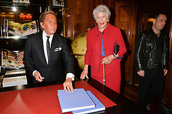 VALENTINO GARAVANI and MARIA CARMELLA, VISCOUNTESS HAMBLEDEN at a party to celebrate the launch of the Maison Assouline Flagship Store at 196a Piccadilly, London on 28th October 2014.  During the evening Valentino signed copies of his new book - At The Emperor's Table.