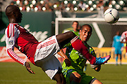 Sept. 16, 2012 - Portland, Oregon, US - Portland Timbers FUTTY DANSO (98/red) kicks over Seattle Sounders DAVID ESTRADA (16/green) in soccer action between the Portland Timbers Reserves and the Seattle Sounders FC Reserves. Portland took the win 3-2. (Credit Image: © Ken Hawkins/ZUMAPRESS.com)