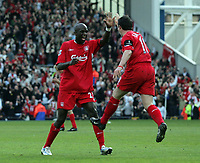 Photo: Paul Thomas.<br /> Blackburn Rovers v Liverpool. The Barclays Premiership. 16/04/2006.<br /> <br /> Liverpool's Robbie Fowler celebrates his goal with team mate Momo Sissoko.