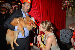 ANDRE DE TRICHATEAU and his dog Luca meet ALESSANDRA BALAZS at the Tatler Magazine's Kings & Queens party held at Savini at Criterion, Piccadilly, London on 1st June 2016.