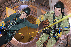Royal Marines abseil down BT Tower. the BT Tower, London, United Kingdom. Embargoed until Monday, 17th February 2014. Picture by Anthony Upton / i-Images<br /> <br /> HISTORIC MOMENT FOR BT TOWER AS CHARITY ABSEIL GETS THE GREEN LIGHT<br /> TV presenter Helen Skelton and Commandant General of the Royal Marines, Major General Ed Davis CBE during the training at the Castle Climbing centre, in north London ahead of the first ever charity abseil down BT Tower will take place on 10 March to raise money for Sport Relief and the Royal Marines Charitable Trust Fund using BT's MyDonate online fundraising site.<br /> <br /> The event will also kick off a year of celebrations for the 350th anniversary of the Royal Marines, during which the Royal Marines Charity Trust Fund (RMCTF) aim to raise £6million