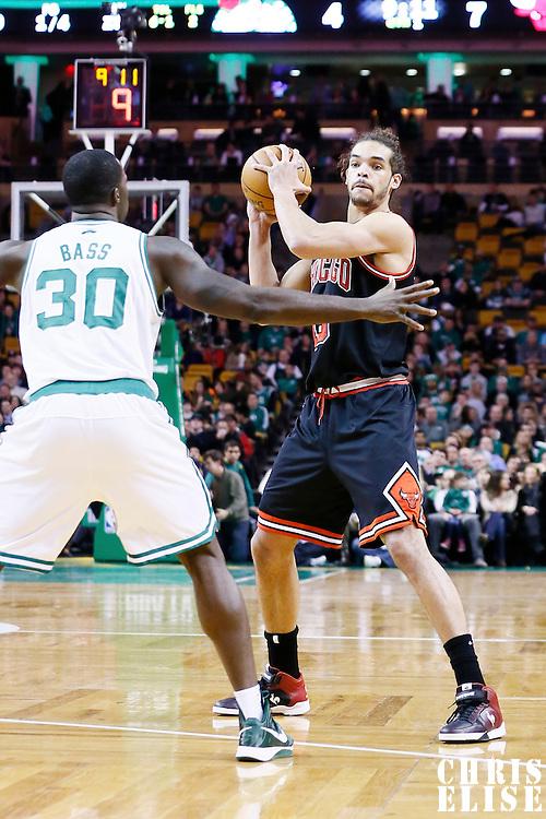 18 January 2013: Chicago Bulls center Joakim Noah (13) looks to pass the ball during the Chicago Bulls 100-99 overtime victory over the Boston Celtics at the TD Garden, Boston, Massachusetts, USA.