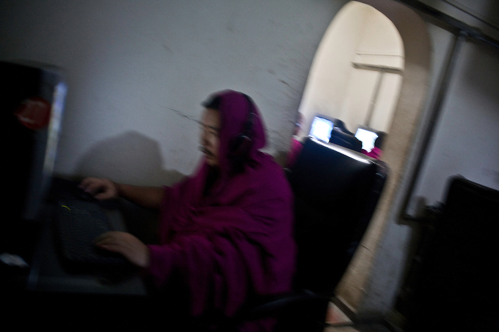 A monk of the monastery of Labrang is chatting on internet with friends.. In spite of the control of the communications by chinese authorities, monks stay well informed of  the events related to Tibet and specially to the Dalai Lama, partly because of the difficulty for censors to monitor all the traffic written in tibetan.