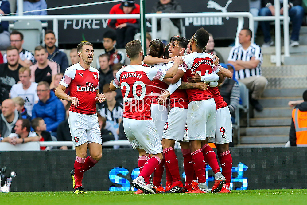 Mesut Ozil (#10) of Arsenal celebrates Arsenal's second goal (0-2) with Arsenal team mates during the Premier League match between Newcastle United and Arsenal at St. James's Park, Newcastle, England on 15 September 2018.