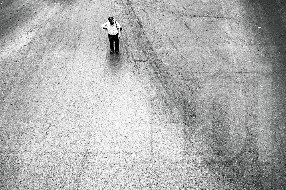 Lone silhouette of a man stopped in the middle of Ratchaprasong Intersection, Bangkok, Thailand, Southeast Asia