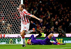 Peter Crouch of Stoke City celebrates in front of a dejected Heurelho Gomes after scoring his sides second goal  - Mandatory by-line: Matt McNulty/JMP - 03/01/2017 - FOOTBALL - Bet365 Stadium - Stoke-on-Trent, England - Stoke City v Watford - Premier League