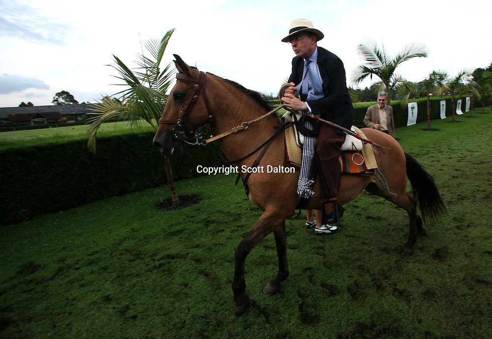 President Alvaro Uribe of Colombia rides a horse at a country club just outside of Medellin, Colombia, on September 15, 2007. (Photo/Scott Dalton)