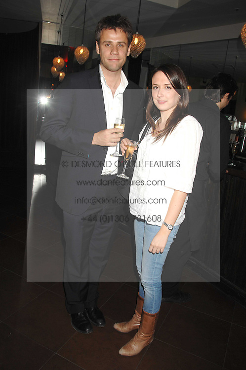 RICHARD BACON and REBECCA MCFARLANE at a party to celebrate the publication of Piers Morgan's book 'Don't You Know Who I Am?' held at Paper, 68 Regent Street, London W1 on 18th April 2007.<br />