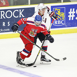 COBOURG, - Dec 14, 2015 -  Game #3 - United States vs Czech Republic at the 2015 World Junior A Challenge at the Cobourg Community Centre, ON. Ondrej Najman #10 of Team Czech Republic and Collin Peters #17 of Team United States battle for the puck during the first period.(Photo: Tim Bates / OJHL Images)