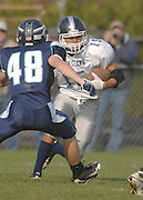 Petoskey's Chase Ledingham (48) closes in on John Glenn's Devin McCulloh (15) during a second half kickoff return Saturday in Petoskey.