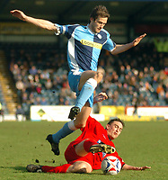 Photo: Leigh Quinnell.<br /> Wycombe Wanderers v Shrewsbury Town. Coca Cola League 2. 11/03/2006. Shrewsburys Mark Stallard challenges Wycombes Roger Johnson.