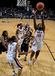 Virginia Cavaliers C Aisha Mohammed (33) grabs a rebound.  The Virginia Cavaliers women's basketball team fell to the #14 ranked George Washington Colonials 70-68 at the John Paul Jones Arena in Charlottesville, VA on November 12, 2007.