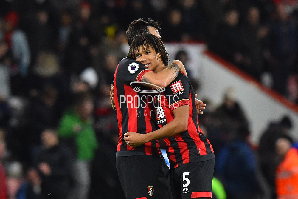 Charlie Daniels (11) of AFC Bournemouth and Nathan Ake (5) of AFC Bournemouth hug at full time after a 2-1 win over Huddersfield during the Premier League match between Bournemouth and Huddersfield Town at the Vitality Stadium, Bournemouth, England on 4 December 2018.