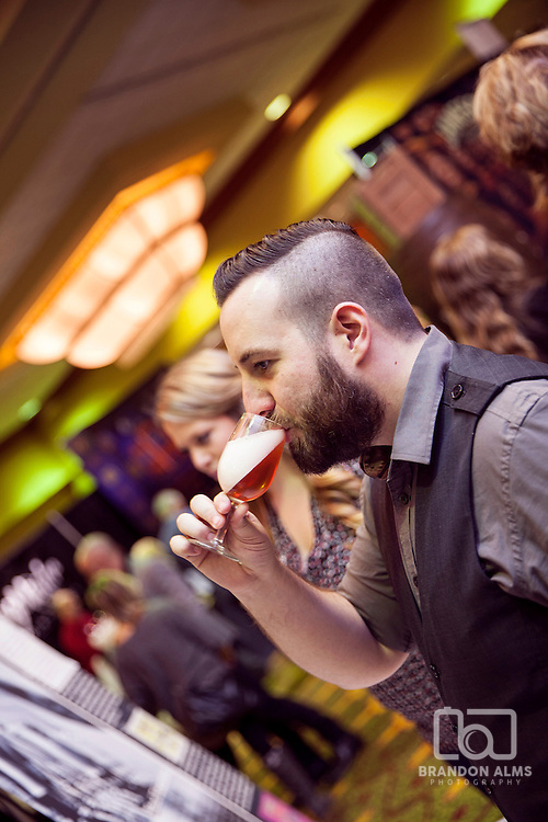A man samples a drink at 417 Magazine's 2015 Whiskey Fest.