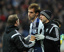 West Bromwich Albion's Craig Dawson receives treatment after a head collision with Stoke City's Jonathan Walters  - Photo mandatory by-line: Dougie Allward/JMP - Mobile: 07966 386802 - 14/03/2015 - SPORT - Football - Birmingham - The Hawthorns - West Bromwich Albion v Stoke City - Barclays Premier League