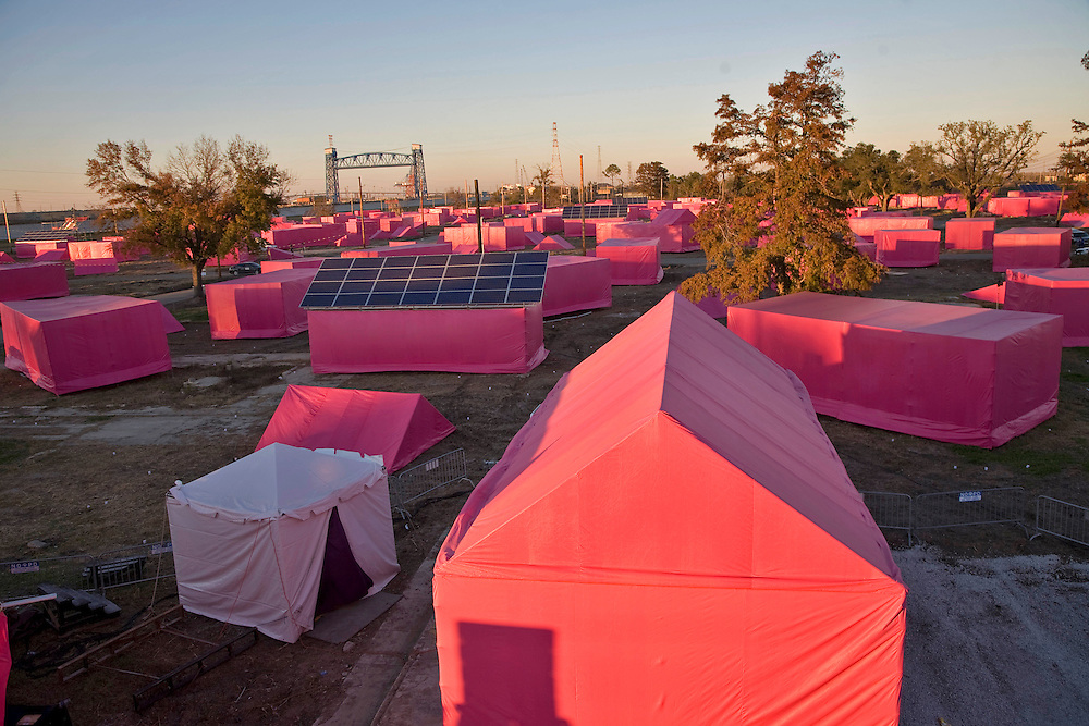 """Pink  models set up to as model of houses that will be built light up the lower 9th ward sky to introduce Brad Pitts affordable housing project in New Orleans.Brad Pitt introduced his """"Making it Right"""" low income housing project in the 9th Ward of New Orleans,on December 3, 2007 with a presentation of symbolic pink houses where ultimately environmentally friendly homes will be built."""