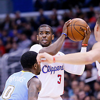 15 April 2014: Los Angeles Clippers guard Chris Paul (3) looks to pass the ball during the Los Angeles Clippers 117-105 victory over the Denver Nuggets at the Staples Center, Los Angeles, California, USA.