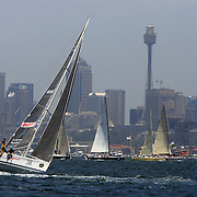 Yacht's jockey for position with a backdrop of the City of Sydney before the start of the 64th Rolex Sydney to Hobart Yacht Race 2008 which began in the waters of Sydney Harbor. Exactly 100 yacht's entered in this years race with spectators on the Sydney Harbor foreshore estimated to have reached over 500,000 people on December 26, 2008. Maxi Wild Oats XI skippered by Mark Richards was looking to make history with a record fourth consecutive line honors victory.