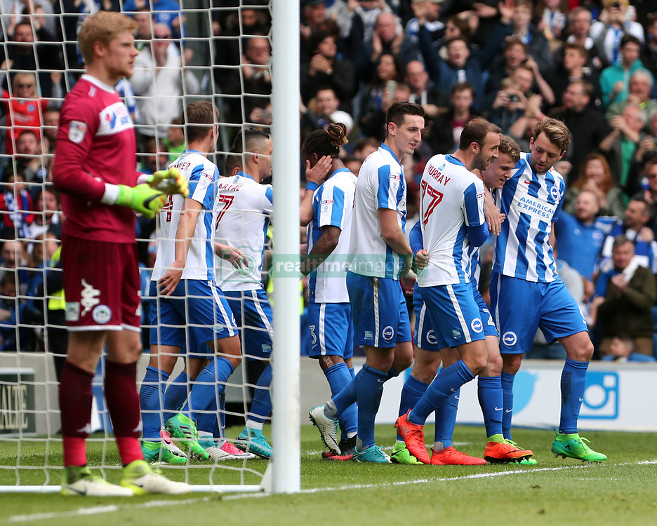 Brighton and Hove Albion's Solly March (second from right) is congratulated after scoring the second goal for his side during the Sky Bet Championship match at the AMEX Stadium, Brighton.
