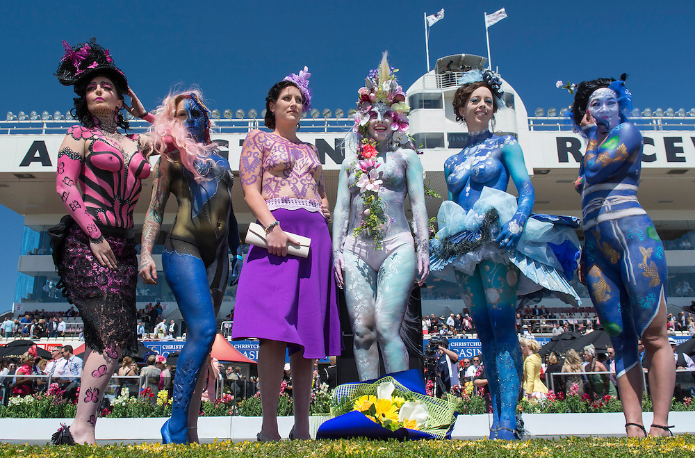The winner, 4th from left Hannah Hamilton models a design painted by Melodie McColl, with contestants in the Best Body Art contest at the New Zealand Trotting Cup Day, Addington Raceway, Christchurch, New Zealand, Tuesday, 11 November, 2014. <br /> Credit:SNPA / David Alexander