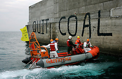 "CIVITAVECCHIA, 16 October 2008 – This morning, Greenpeace activists paint ""Quit Coal"" on Enel's new coal fired power plant in Civitavecchia. Greenpeace is calling on the Italian Government to declare an immediate moratorium on all new coal-fired power plants. ....jre/Photo by GREENPEACE / Jiri Rezac"