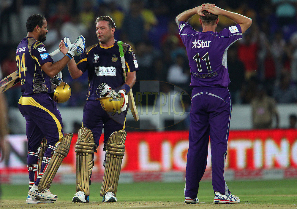 Jacques KALLIS of the Kolkata Knight Riders and Yusuf PATHAN of the Kolkata Knight Riders celebrate the win during the first semi final match of the Oppo Champions League Twenty20 between the Kolkata Knight Riders and the Hobart Hurricanes held at the Rajiv Gandhi Cricket Stadium, Hyderabad, India on the 2nd October 2014<br /> <br /> Photo by:  Ron Gaunt / Sportzpics/ CLT20<br /> <br /> <br /> Image use is subject to the terms and conditions as laid out by the BCCI/ CLT20.  The terms and conditions can be downloaded here:<br /> <br /> http://sportzpics.photoshelter.com/gallery/CLT20-Image-Terms-and-Conditions-2014/G0000IfNJn535VPU/C0000QhhKadWcjYs