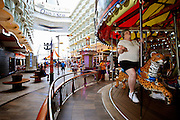 A tiny asmusement park includes a carousel onboard the cruise ship Oasis of the Seas. The ship, currently the largest in the world, is owned by Royal Carribean Cruise Line.