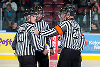 KELOWNA, CANADA - OCTOBER 4:  Brett Iverson, referee, Mike Langin, Linesman, Nick Swaine, referee and Kevin Crowell, linesman stand on the ice at the Kelowna Rockets on October 4, 2013 at Prospera Place in Kelowna, British Columbia, Canada (Photo by Marissa Baecker/Shoot the Breeze) *** Local Caption ***
