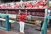 ANAHEIM, CA - JULY 20:  Mike Morin #64 of the Los Angeles Angels of Anaheim signs autographs for fans with his baseball glove on his head before the game against the Seattle Mariners at Angel Stadium on Sunday, July 20, 2014 in Anaheim, California. The Angels won the game 6-5. (Photo by Paul Spinelli/MLB Photos via Getty Images) *** Local Caption *** Mike Morin
