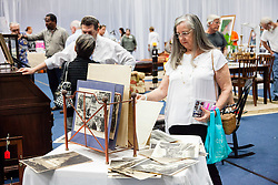 Patricia Zolten takes a closer look at  22 historic  photographs of Virgin Islands and Puerto Rican landscapes and landmarks.  The Hebrew Congregation of St. Thomas presents its seventeenth annual Antiques, Art & Collectibles at Antilles' MCM Center.  The annual silent and live auction supports upkeep and maintenance of the Historic Synangogue and its community programs.   St. Thomas, USVI.  21 February 2016.  © Aisha-Zakiya Boyd