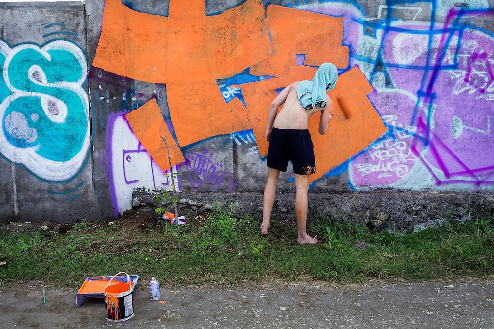 Touching up murals in Canggu.