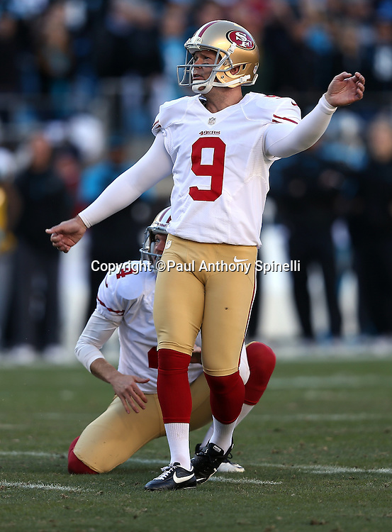 San Francisco 49ers kicker Phil Dawson (9) kicks a 34 yard fourth quarter field goal good for a 23-10 Niners lead during the NFC Divisional Playoff NFL football game against the Carolina Panthers on Sunday, Jan. 12, 2014 in Charlotte, N.C. The 49ers won the game 23-10. ©Paul Anthony Spinelli