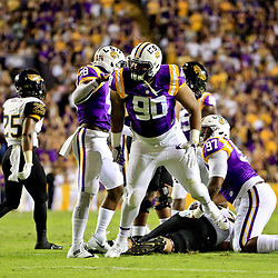 Oct 15, 2016; Baton Rouge, LA, USA;  LSU Tigers defensive tackle Rashard Lawrence (90) celebrates after a defensive stop against the Southern Miss Golden Eagles during the first half of a game at Tiger Stadium. Mandatory Credit: Derick E. Hingle-USA TODAY Sports