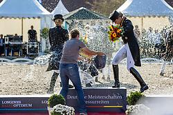 BREDOW-WERNDL Jessica von (GER), WERTH Isabell (GER), SCHNEIDER Dorothee (GER)<br /> Meisterdusche<br /> Siegerehrung/Meisterehrung<br /> Longines Großer Optimum Preis <br /> präsentiert von das Meggle GmbH & Co. KG<br /> Nat. Dressurprüfung Kl. S**** - Grand Prix Kür <br /> Finale Deutsche Meisterschaften<br /> Balve Optimum - Deutsche Meisterschaft Dressur 2020<br /> 20. September2020<br /> © www.sportfotos-lafrentz.de/Stefan Lafrentz
