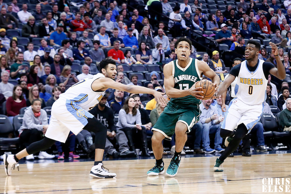 03 February 2016: Milwaukee Bucks guard Malcolm Brogdon (13) drives past Denver Nuggets guard Emmanuel Mudiay (0) and Denver Nuggets guard Gary Harris (14) during the Denver Nuggets 121-117 victory over the Milwaukee Bucks, at the Pepsi Center, Denver, Colorado, USA.