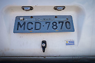 An Argentinian registration plate on the back of a VW campervan at the site set up for football fans who had nowhere to stay but the tents, campervans, cars and caravans that they had bought with them. The site, at the Terreirao Do Samba, Rio de Janeiro, Brazil, was arranged by the city government once they realised the number of fans in this situation was significant and rather than having them scattered about the sity they offered secure, enclosed accommodation with sanitation and water. The majority of fans at the site were Argentinian but there were also people from Chile, USA, Uruguay and Colombia. Photo by Andrew Tobin/Tobinators Ltd