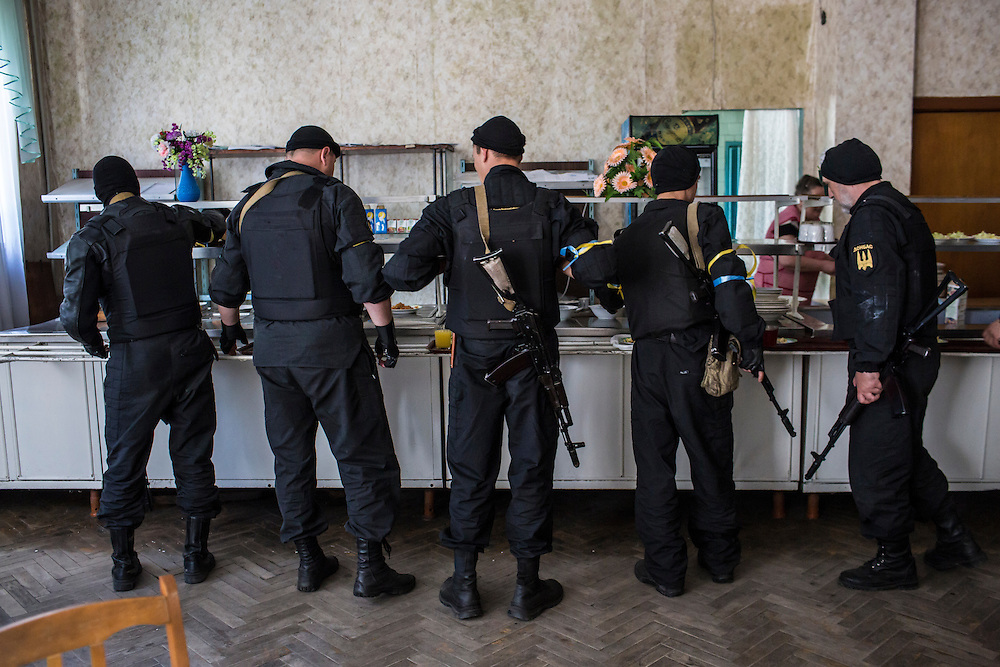 DOBROPILLYA, UKRAINE - MAY 21:  Members of the Donbass Battalion, a pro-Ukraine militia, get lunch in a local cafeteria on May 21, 2014 in Dobropillya, Ukraine. Days before presidential elections are scheduled, questions remain whether the eastern regions of Donetsk and Luhansk are stable enough to administer the vote. (Photo by Brendan Hoffman/Getty Images) *** Local Caption ***